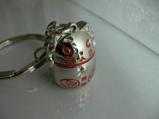 http://www.ebay.com/itm/The-Maneki-Neko-Lucky-Cat-keychain-keyring-key-chain-/170426204143?_trksid=p2054897.l4276
